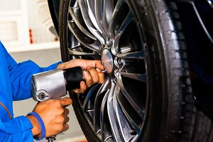 Mechanic screwing wheel