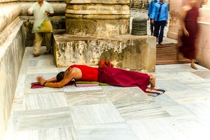 Tibet monk on the ground for praying
