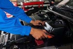 Mechanic fixing a broken car