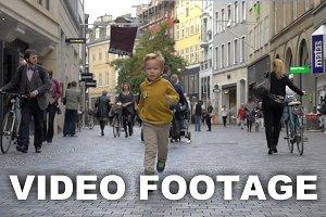 Little Boy Running on the Street