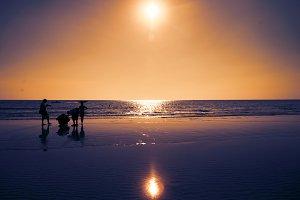 People on the beach silouhette