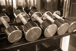 Dumbell in gym fitness vintage