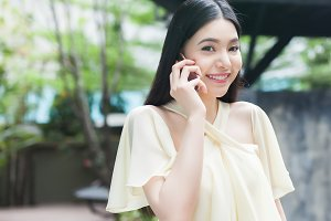 Beautiful Asian woman talking on the phone