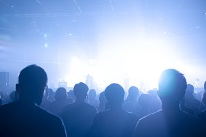Music concert crowds illuminated from stage lights (very shallow depth of field)