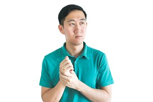 Serious Asian man thinking about something on isolated white background