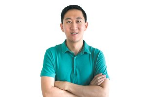 Asian man smiling crossed arms isolated on white background