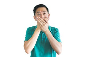 Young Asian man covering his mouth with hands