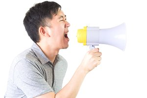 Young Asian man shouting with a megaphone isolated white background with clipping path