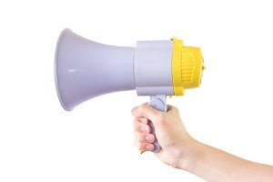 Close up of male hand holding megaphone isolated white background with clipping path