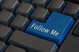 Word 'Follow Me' on enter keyboard - social media concept