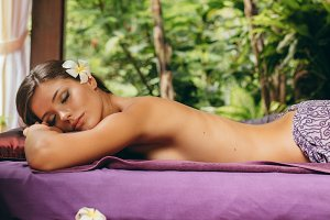 Relaxed woman lying on massage
