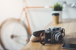 Vintage camera on the wooden table