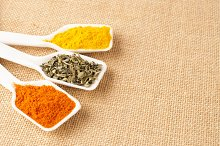 turmeric and spices isolated on jute