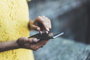 Female hands using modern smartphone