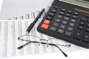 Pen, glasses and calculator