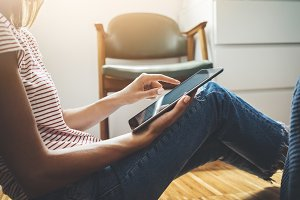 Hipster girl using digital tablet
