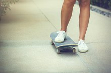 Close-up of teenage girl skateboarding in the park