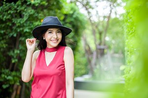 Fashionable Asian woman in green nature background