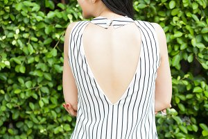 Woman's bright back and spine in fashionable dress