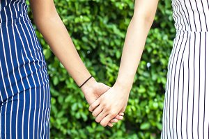 Female best friend forever holding hands together - friendship and love concept