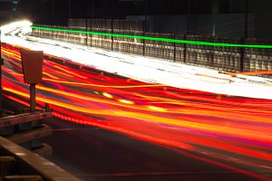 Abstract image of the light trails in night traffic in the city. Speeding concept