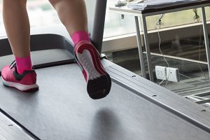 Woman workout with treadmil in gym