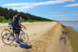 Couple travel by bicycle. Blurry