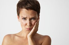 young woman with a tooth pain