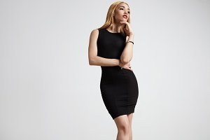 woman wears black dress