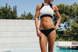 Fit woman athlete in swimwear