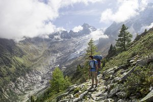 Hiker looks around in the Alps