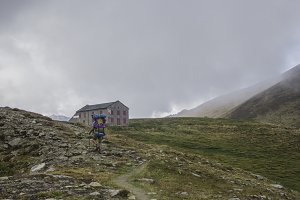 Hiker walking to a hut in the Alps