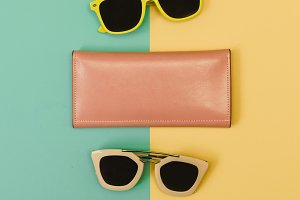 two sunglasses and purse