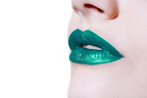 woman lips with green lipstick