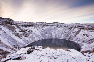 Kerid (or Kerith) volcanic crater lake on the touristic golden circle route in Iceland in winter