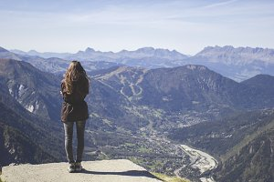 Girl enjoying the view in а mountain