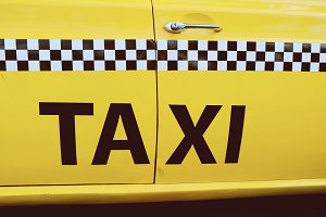 The side of NYC yellow taxi cab