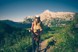 Girl Traveler hiking mountains