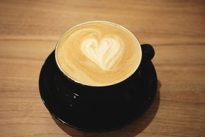 Hot cafe latte with heart shape