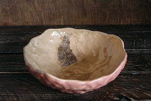 ceramic bowl on a brown background