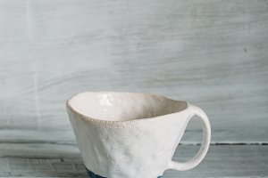 white ceramic cup with a blue stripe