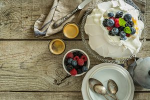 Pavlova with berries and coffee