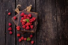 Organic Raspberries on wooden table