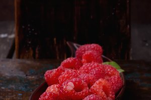 Raspberries on curve plate