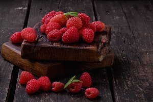 Raspberries on wooden boards
