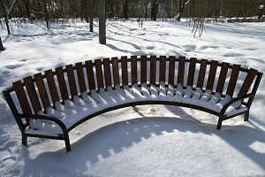 Snow-covered bench.