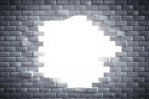 Light coming through brick wall hole