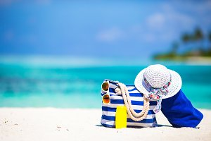 Beach accessories on white tropical beach