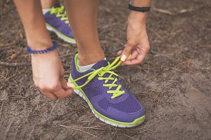 Runner woman tying shoelaces