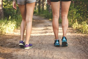 fitness girl legs at forest trail